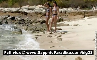agreeable dark brown lesbos giving a kiss and