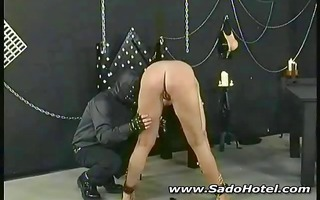dark brown slave is tortured by her masked