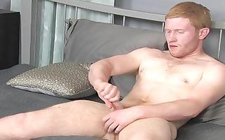 redhead man stroking alone in bedroom
