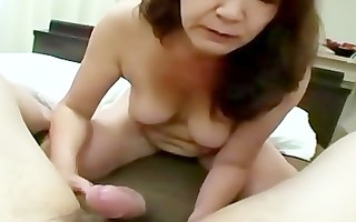 hawt mature whore is giving head