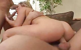 blond woman sucks schlong down on her knees on