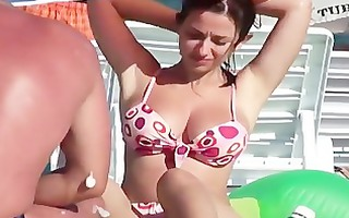 candid beach - breasty dark brown pink bikini