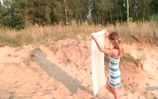czech playgirl shows pink on the hawt sand