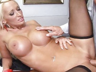 Busty blonde in a black stockings get a dick