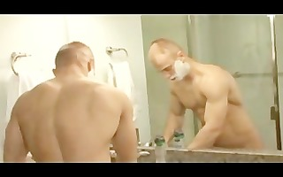 2 muscular guys fuck in bathroom