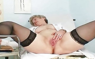 breasty granny in uniform stretching her mature