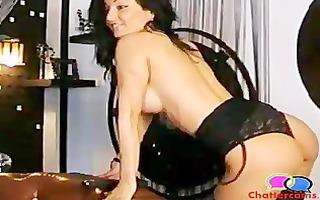 black haired gymnast dances on livecam